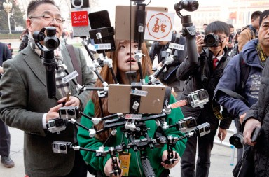 A journalist operate a harness with multiple recording devices capable of recording and live streaming outside the Great Hall of the People where the opening session of the Chinese People's Political Consultative Conference (CPPCC) was held in Beijing, China, Friday, March 3, 2017. Thousands of delegates have gathered at the Chinese capital for the opening of the annual session of the Chinese People's Political Consultative Conference, which advises the rubberstamp parliament, whose annual session begins Sunday. (AP Photo/Ng Han Guan)