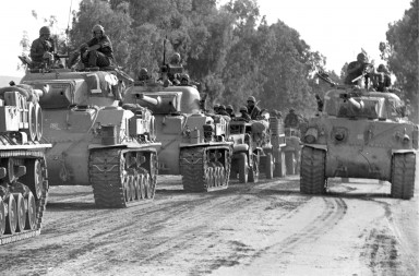 A convoy of Israeli tanks rolls towards the front during the 1967 Middle East War, widely known as the Six Day War, in this picture released on June 4, 2007 by Israel's Defence Ministry. Forty years ago this week, Israel swept to victory in six days in a war with Egypt, Syria and Jordan, capturing the Sinai peninsula, Golan Heights, Gaza Strip and West Bank, including Arab East Jerusalem.  REUTERS/Israeli Defence Ministry/Handout    BLACK AND WHITE ONLY.  EDITORIAL USE ONLY. NOT FOR SALE FOR MARKETING OR ADVERTISING CAMPAIGNS.